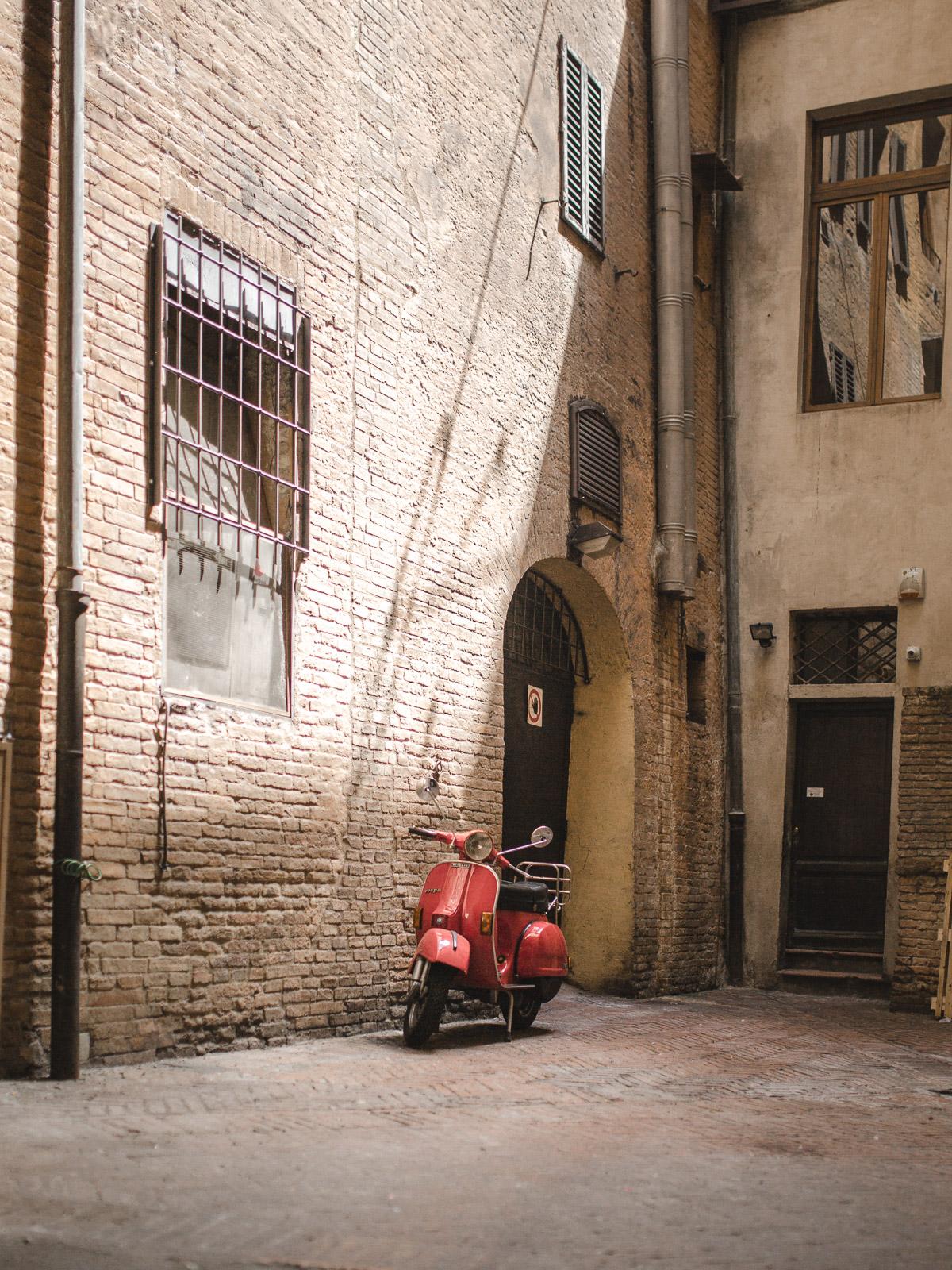 siena italy tuscany red moped